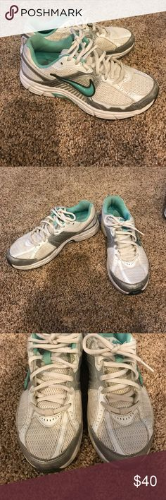 White, gray, and blue Nike tennis shoes White, gray, and blue Nike Dart 7 tennis shoes. Gently worn (see pics). Nike Shoes Athletic Shoes
