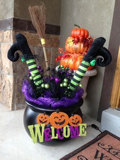 """Witch legs in a cauldron: 18"""" black cauldron & cute broom (both from Harmons), purple lights, purple & black mesh, picks from Michael's, witch table legs (from celebrate express) - stuffed with a pool noodle. Fake Spider, Entrance, Corner, Yard, House, Wreaths, Halloween Decorations, Home Decor, Homemade Home Decor"""