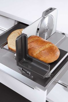Fold-up all-purpose slicer is one of FORM Kitchens' features for made-to-order kitchen remodeling. #EuroStyleKitchens #HighQualityKitchenCabinets Clever Kitchen Storage, Kitchen Drawer Organization, Kitchen Drawers, Kitchen Cabinet Design, Organization Ideas, Wall Shelving Units, Pantry Shelving, Pull Out Pantry, Order Kitchen