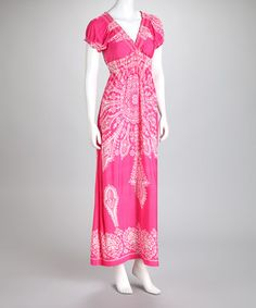 Between the pretty pattern and the posh puffed sleeves, this glamorous gown is completely captivating. This sweeping frock makes a fabulous go-to. Size note: This item runs small. Please refer to the size chart.