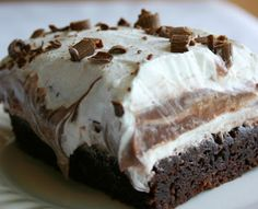 1 box brownie mix 1 extra large egg 1 (8 oz.) package cream cheese, softened 1 cup powdered sugar 2 (8 oz.) containers whipped topping ...