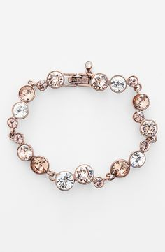 Bubbly silver and rose gold line bracelet with radiant crystals.