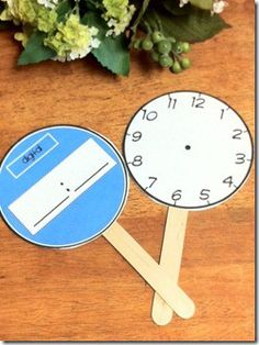 Laminated analog and digital clocks on tongue depressor