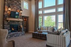 Wall of windows in Two Story Family Room