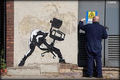 Banksy - Chair smash (based on London Calling album cover).   The Clash's London Calling album cover is widely considered to be one of the best album covers of all time. Its a photo that is far from technically perfect but it captures a moment of rage beautifully