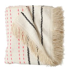 Bright neon pink dashes give this hand-woven blanket lots and lots of pops of color. Its neutral background coordinates with almost any nursery decor.