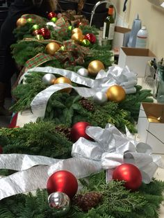 What you need to design your own fresh wreath: 9 bulbs ( 5 of one color 4 of the other )  1 large bow to coordinate with bulbs Taped medium wire Pine cones, berries (optional)