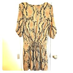 Chic snakeskin dress Snakeskin print dress with roll tab sleeves and a drawstring waist. Can also be worn as a long tunic type top. Great with leggings. Re-posh: cute but too small for me. Dresses Mini
