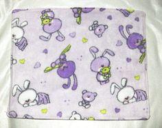 This cute rabbits lap pad is meant for bonding time with your pet! Made from soft fleece it is sure to make the experience enjoyable for all!  Approx. Size W x L: 38 x 46 cm (15 x 18 inches)  This is made for pet owners, by pet owners in a smoke free home! The patterns may vary slightly depending on the print size! Machine washable/Dryer safe on low  NOTE I will refund any shipping overages on applicable orders!  If you would like a custom design or size on any of my items, please feel free…