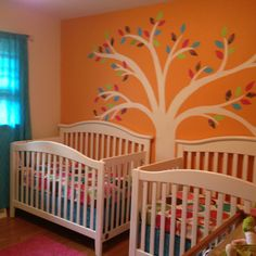 Our twin girls nursery wall- finally finished! The hand painted tree works perfectly with the scrapbook paper leaves we cut out...I am in love with it!! @shallon alford i van paint this tree for you