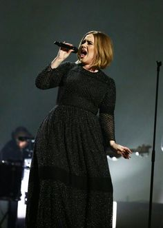 Adele performing on the'X-Factor' in a custom Burberry gown.