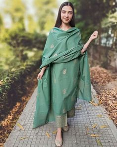 This classy pure cotton set in green is adorned with beautiful hand block prints. The set includes a pure cotton hand block printed dupatta in green which enhances the entire look of the ensemble.