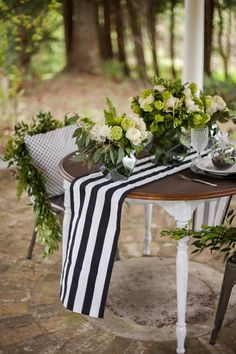 For a preppy outdoor wedding, decorate your sweetheart table with a black and white stripped runner, tall candles, polkadot chair pillows and peony flower arrangements. {Photo: Samantha McFarlen, Event Planner: Bixby + Pine}