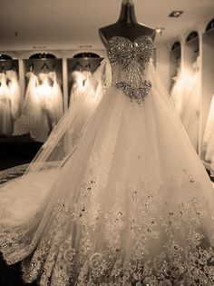 Stone model with plenty of wedding dresses
