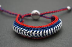 A friendship link bracelet in London colors.