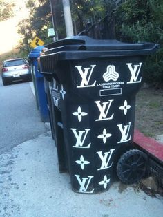 Would not put Louis Vuitton on a trash can!!!! It is a cute idea though.