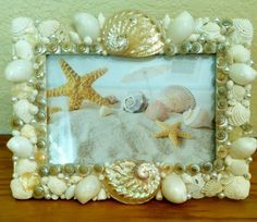 sea shell picture frame by Idratherbeshelling on Etsy https://www.etsy.com/listing/223303045/sea-shell-picture-frame