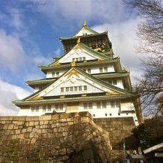 """The Osaka Castle tower is surrounded by secondary citadels, gates, turrets, impressive stone walls and moats. The Nishinomaru Garden, encompassing the former """"western citadel"""", is a lawn garden with 600 cherry trees, a tea house, the former Osaka Guest House and nice views of the castle tower from below. This picture was taken in the winter, Feb. 2014."""