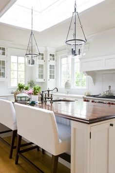 modern farmhouse kitchen..love the skylight and the double seat benches! + beachy kitchen + white + neutral color pallet