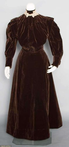 """BROWN VELVET DAY ENSEMBLE, c. 1905 3-piece chocolate cotton velvet, gored skirt, W 24.5"""", L 36"""", & 2 bodices: 1 day bodice, high band collar w/ lace trim, long puff sleeves, B 32"""" & 1 evening bodice, deep V F & B, brown silk trim, B 36"""", (skirt w/ line of worn marks 3"""" above hem, 2 bodices of different sizes)"""