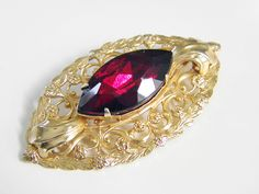 Vintage Ruby Red Rhinestone Art Nouveau Brooch. $32.00, via Etsy.