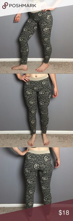 nikibiki floral print leggings These fun, flexible leggings are so comfy, they fit like a second skin. Very soft on the inside. Stretchy waistband. Black floral print that looks like a lace overlay printed on a cream/tan background. In good used condition. Fabric content is 92% nylon, 8% spandex. Made in USA. Size tag says one size but I'd say they fit like a small. Nikibiki Pants Leggings
