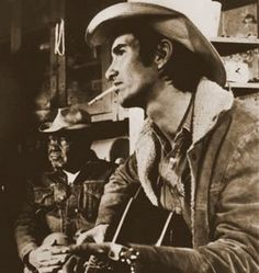 Black and white screen shot of Townes Van Zandt in the film Heartworn Highways.