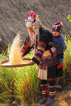 traditional indigenous clothing and method of winnowing rice, Doi Pha Hom Pok National Park, Thailand
