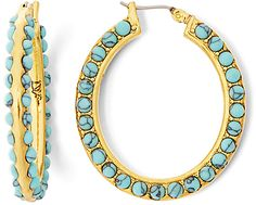 Details One of a kind turquoise stones are embedded in gold to create this stunning hoop earring inspired by the ocean. Gold plated with semi-precious stone. Click top closure. <ul> <li>Gold Plated Brass.</li> <li>Use a soft cloth to remove smudges and dirt. Always put on your jewelry after makeup and hair spray, and remove before entering water.</li> <li>Width:0.5 cm / 0.2 in</li> </ul>