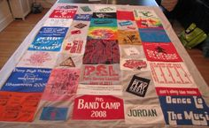 T-shirt Quilt  I want to do something like this with my T-shirts from high school.