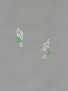 Jewellery design for a pair of diamond and emerald clips.
