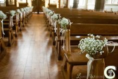 Laurel Weddings can create stunning wedding ceremony flowers, including wedding flower arch, pedestal arrangements, pew ends, aisle decorations and aisle runners.