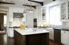 Kitchen white & espresso brown, kitchen island with marble countertops, white carrara marble subway tiles backsplash, white glass-front kitchen cabinets