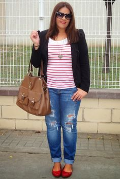 Red/white shirt, black cover up, ripped jeans, red flats. Cute and simple.  :-)