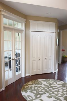 DIY: How to Make Doors Appear Taller or All the Same Height - a great way to give your home a custom built look - via The Yellow Cape Cod