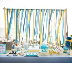Note the use of the ribbons/streamers. The backdrop becomes a moving/dynamic addition to the party.
