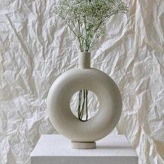 Wheel-thrown and hand altered donut shaped stoneware vase. Natural unglazed exterior with Translucent Matte glazed interior. Ceramic Painting, Ceramic Vase, Ceramic Sculpture Figurative, Keramik Design, Donut Shape, Terracota, Minimalist Home Decor, White Vases, Pottery Vase