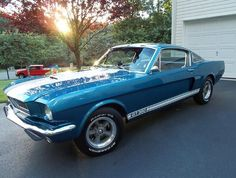 """1966 Shelby GT350 – numbered SFM6S1747 – is handsomely finished in Sapphire Blue with Wimbledon White stripes and has been restored using New Old Stock parts wherever possible. The engine is a 289 High-Performance K-Code block, with the donor Hi-Po VIN and """"K"""" stamped above the oil pan rail. Both the block and Hi-Po cylinder heads are date-code appropriate."""
