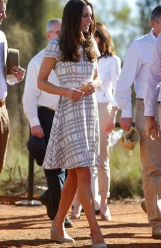 Sensible style: Kate's wedges were a better choice for the desert soil than high heels. Picture: Gregg Porteous Source: News Corp Australia