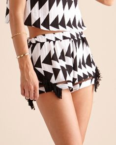 Bermuda Short by Suboo in black and white with black lattice and fringe detailing.   Looks great worn as a matching set with the Bermuda Tee, shown here, or with your bikini.    www.birdmotel.com.au