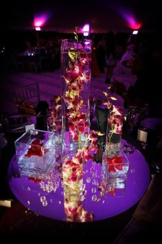 "Square tall vases with bombay submerged orchids and LED lighting on 30"" mirrors.  Photos by Limelight Photography, Flowers by Fudgie"