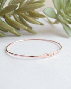 Engraved Open Bangle Bracelet by Olive Yew. This sleek engraved bangle bracelet can be customized or left blank. The lightly hammered ends are the perfect size for your dainty initials or your initial and your sweetheart's. This thin open bangle is adjustable and available in silver, gold and rose gold.