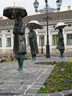 Women with umbrellas: bronze statues by Imre Varga in Obuda, Budapest