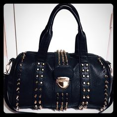 Beautiful studded bag % SAME OR NEXT DAY  gift w/ FULL price offers (Double sided Earrings..any color). **Please use the offer **. **If u have any questions please let me know by commenting & if u have an offer please send it bc I'm a very fair & flexible negotiator**.   **I also bundle so please check out my closet**.                                                                A HUGE THANK YOU to all Poshers who FOLLOW me, SHARE my listings, LIKES my listings, & MAKE OFFERS on my…