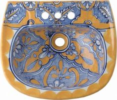 """Rustica Bathroom sink """"Zacatecas"""" has predominantly blue yellow pattern painted over the rustic white background. Model #2416 is a wall mount sink made of ceramic decorated with lead free paint.  by Rustica House #myRustica"""