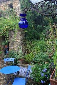 Lovely garden room..hanging blue light..