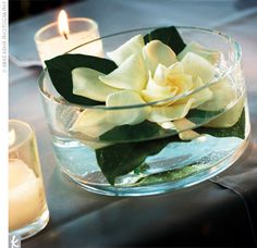 Simple flower arrangement - on top of the book centerpiece. Beveled or interesting vase