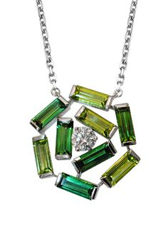 Nine Emerald cut Tourmalines in two shades of green with a center Diamond; a new thought in jewelry making