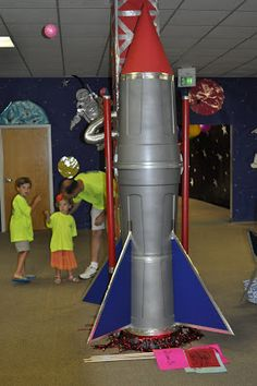 space ship inspiration for kids event, made from trash cans