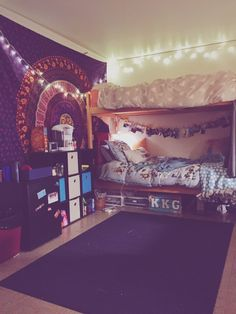 I like the lights, tapestry, and the cube organizer and the coffee and things set on top of it. Good use of space & cute!